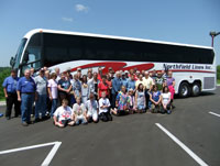 Tour group in front of bus