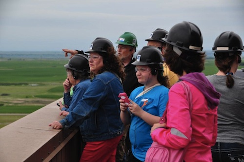 Group of people looking over a ledge