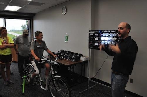 Tour group members using an electric bike