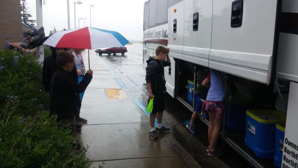 loading cargo into white bus