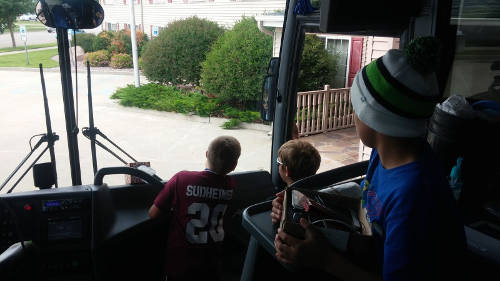 kids in the front of a bus